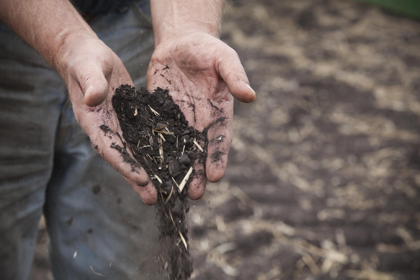 iStock_farmer_holding_compost_Medium.jpg